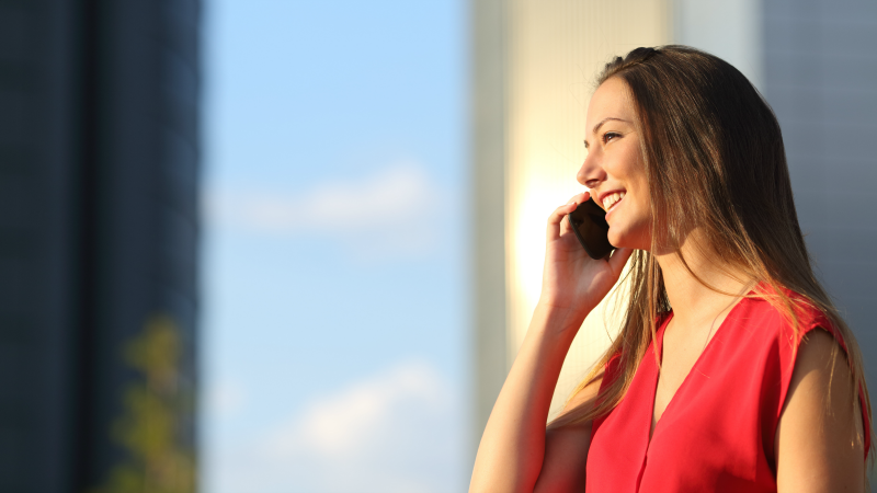 Smiling woman on phone with career consultant on locums assignment