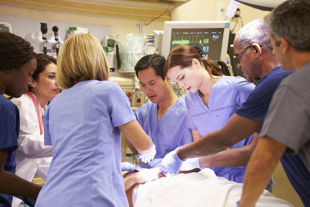 hospital staff working on patient